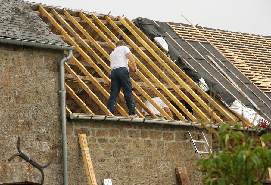 repair to a roof in Kidderminster Worcestershire - men repairing an old roof